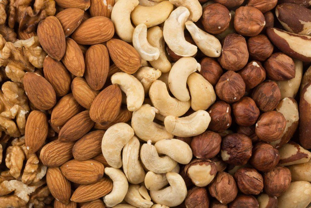 mixe of various nuts background above closeup royalty free image 998937096 1552040898 1